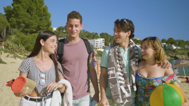 carefree young adults arriving at sunny costa brava - cool box stock videos & royalty-free footage