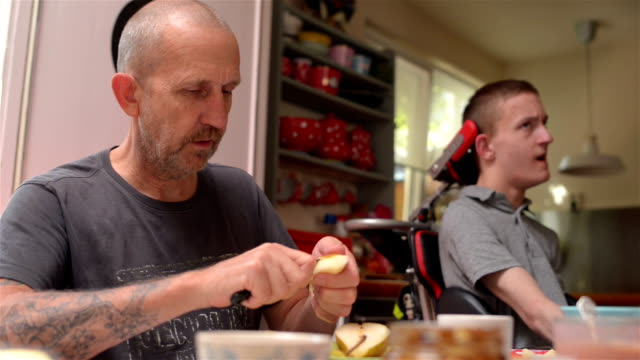 caretaker father with disabled son - physical disability stock videos & royalty-free footage