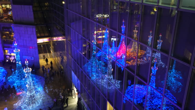 caretta illumination show decoration reflect to the building windows, which is illuminated by approximately 250,000 led lights every 20 minutes in caretta shopping mall shiodome tokyo japan on december 26 2017. - disney stock videos & royalty-free footage