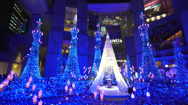 caretta illumination show decoration, which is illuminated by approximately 250,000 led lights every 20 minutes in caretta shopping mall shiodome tokyo japan on january 16 2018. - disney stock videos & royalty-free footage