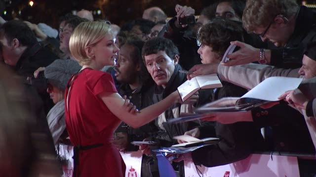 carey mulligan signing autographs at 32nd london critics' circle film awards 2012 red carpet arrivals at bfi southbank on january 19, 2012 in london,... - kritiker stock-videos und b-roll-filmmaterial