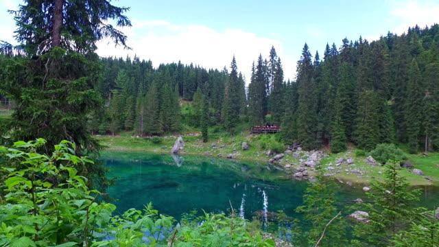 carezza lake - trentino - italy - pjphoto69 stock videos & royalty-free footage