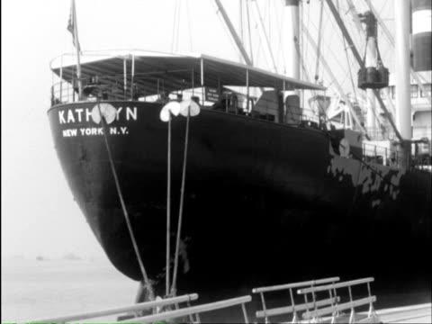 ms cargo being crane lifting onto ship and train moving / southampton, hampshire, england - イングランド サウサンプトン点の映像素材/bロール