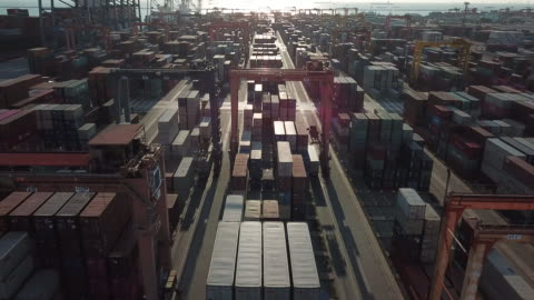 cargo container in port at sunset - harbour stock videos & royalty-free footage