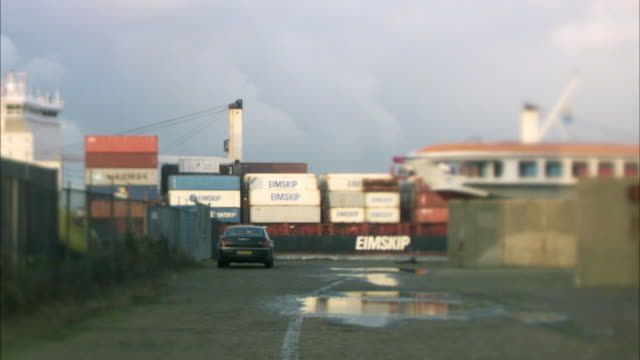 ws cargo container leaving from harbor, car in foreground / rotterdam, netherlands - ship stock videos & royalty-free footage