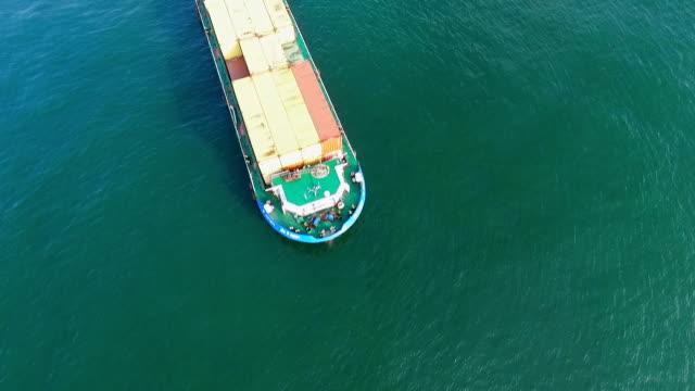 Cargo container trade ship in open sea ocean, AERIAL VIEW