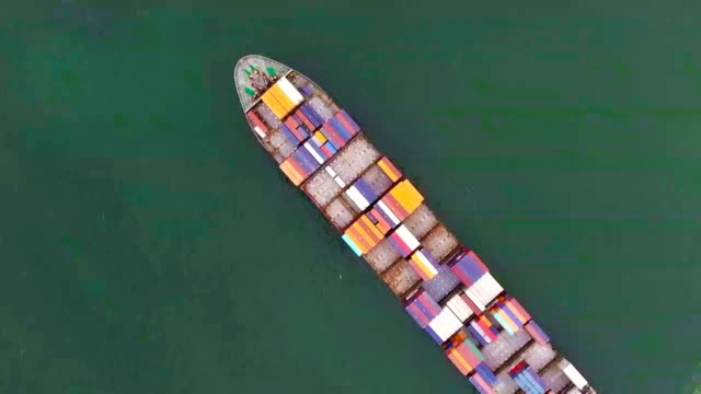 cargo container trade ship in open sea ocean, aerial view - container ship stock videos & royalty-free footage