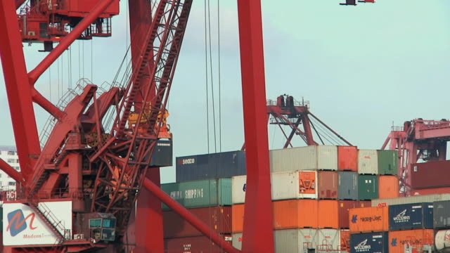 ws td cargo containers being loaded onto barge / hong kong, china - barge stock videos & royalty-free footage