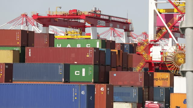 cargo containers in port of shanghai ahead of trade figures release, in shanghai, china, on friday, april 9, 2021. china is scheduled to release... - container video stock e b–roll