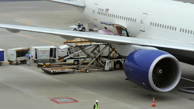 cargo loading to airplane, narita, japan - cargo container stock videos & royalty-free footage