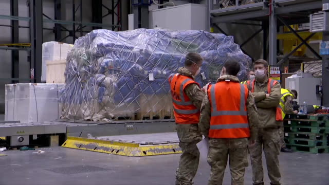 cargo of ppe supplies from turkey being unloaded at warehouse during coronavirus crisis - built structure stock videos & royalty-free footage