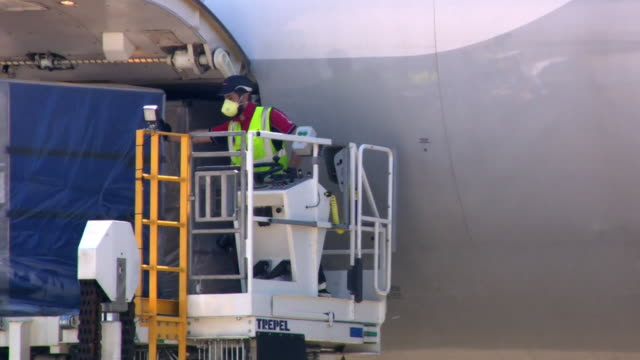 cargo plane carrying ppe supplies from china being unloaded at doncaster airport during coronavirus crisis - freight transportation stock videos & royalty-free footage