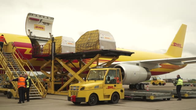 cargo planes landing and being unloaded during the coronavirus lockdown at east midlands airport - freight transportation stock videos & royalty-free footage