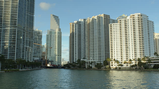 cargo ship amid office towers - miami dade county stock videos & royalty-free footage