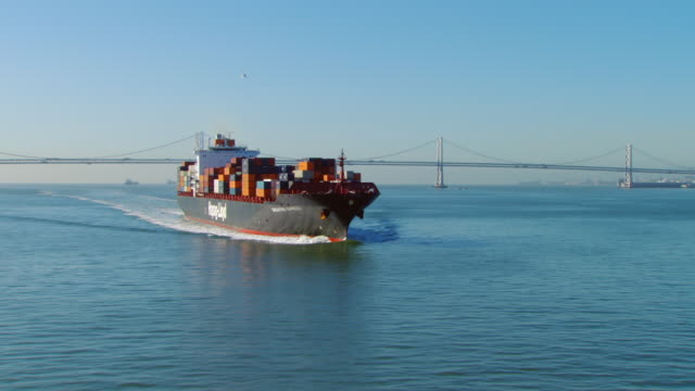 MS AERIAL Cargo ship and Bay Bridge / San Francisco, California, United States