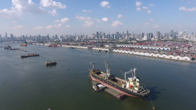 cargo ship barge in the seaport of the port, aerial view - barge stock videos & royalty-free footage