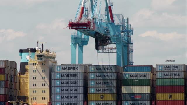 cargo ship being loaded in newark bay - new jersey stock-videos und b-roll-filmmaterial