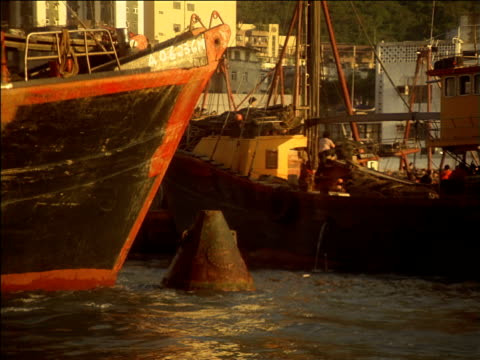 cargo ship bumps into buoy as it passes through hong kong harbour, china - 1987 stock-videos und b-roll-filmmaterial