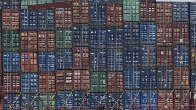 cu cargo ship containers passing to reveal bridge and gantry cranes / los angeles, california, usa - abundance stock videos & royalty-free footage