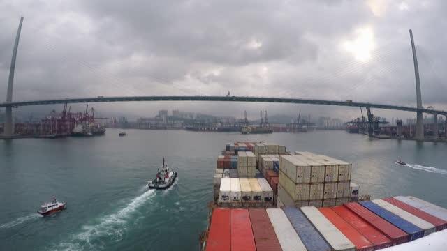 pov cargo ship entering port of hong kong - frachtschiff stock-videos und b-roll-filmmaterial