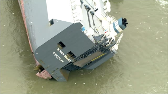 salvage teams assess damage air views of 'hoegh osaka singapore' car transporter ship listing badly to one side after being run aground to prevent it... - capsizing stock videos and b-roll footage