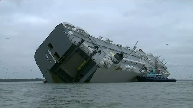 salvage teams assess damage england hampshire the solent ext various of car transporter hoegh osaka listing badly to one side after being run aground... - capsizing stock videos and b-roll footage
