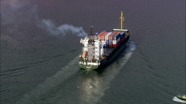cargo ship in cork harbour  - aerial view - munster, cork, ireland - pilot stock videos & royalty-free footage