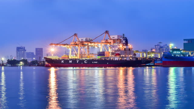 cargo ship in the harbor at full moon - container stock videos and b-roll footage