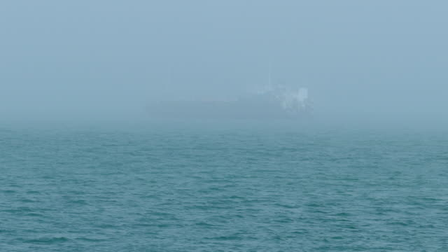 cargo ship in thick fog - hiding stock videos & royalty-free footage