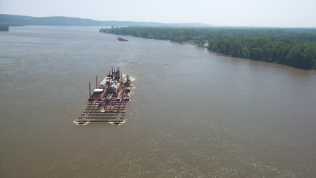aerial ws ds cargo ship moving on mississippi river / st louis, missouri, united states - st. louis missouri stock videos & royalty-free footage