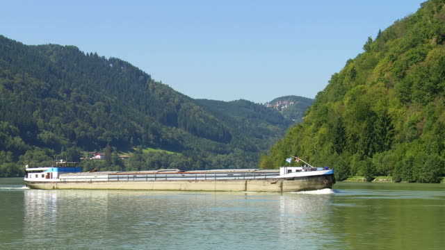 cargo ship on the danube river passing the schloegener schlinge - upper austria stock videos & royalty-free footage