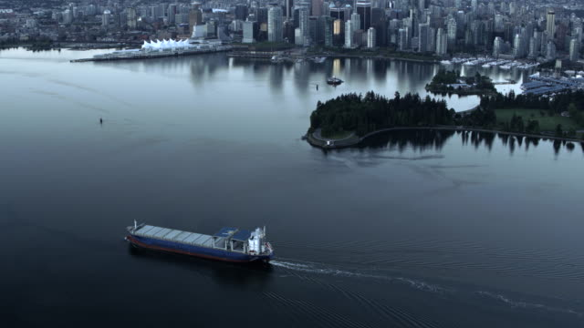 AERIAL Cargo ship passing Stanley Park and sailing into the Vancouver Harbour