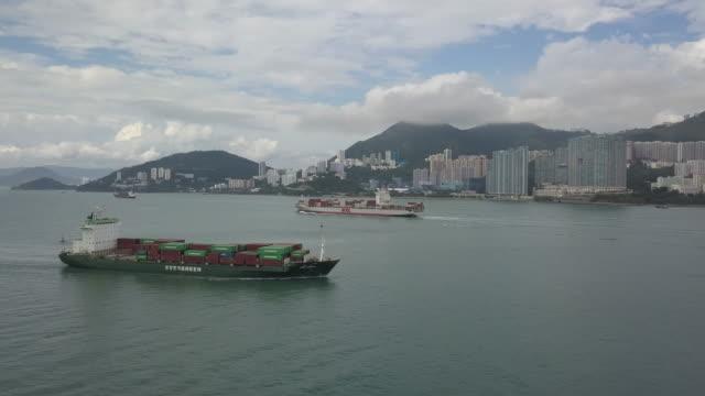 stockvideo's en b-roll-footage met a cargo ship plies the waters to the south of hong kong island hong kong sar china - hongkong eiland