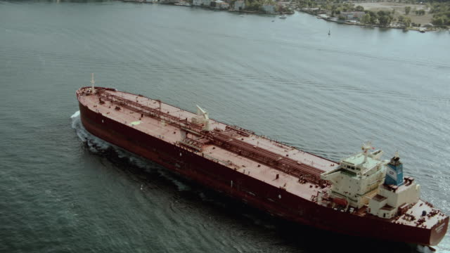 aerial cargo ship traveling through the bosphorous strait / istanbul, turkey - tanker stock videos & royalty-free footage