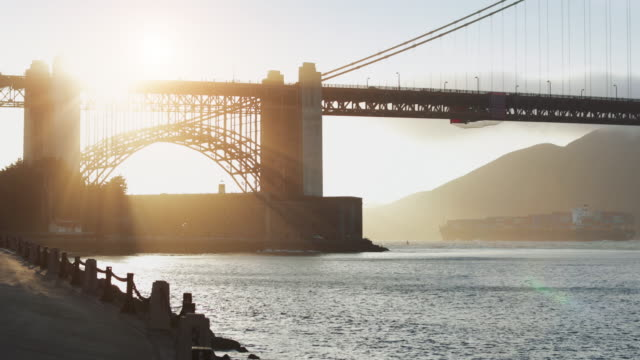 cargo ship under the golden gate bridge - san francisco bay stock videos & royalty-free footage