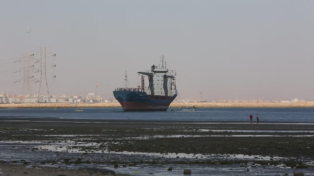 cargo ship waiting to enter the suez canal in suez, egypt on sunday, march 28, 2021.work continues to free the ever given, a huge container ship... - suez canal stock videos & royalty-free footage
