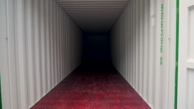 cargo shipping container opening doors. inside view. - box container stock videos & royalty-free footage