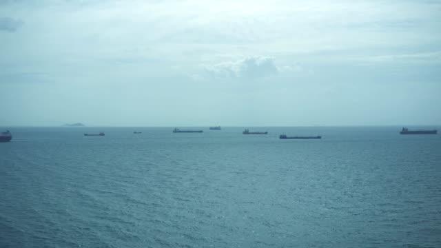 Cargo ships anchored in the sea