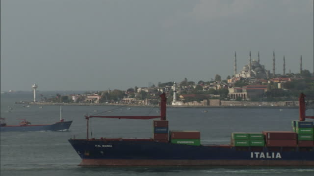 cargo ships approach istanbul, turkey down the coast from the blue mosque. - cargo ship stock videos & royalty-free footage
