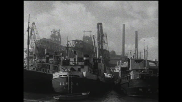 cargo ships are moored near a amagasaki steel mill. - metal industry stock videos & royalty-free footage