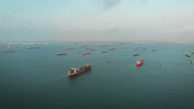 cargo ships on the ocean area near singapore - bay of water stock videos & royalty-free footage