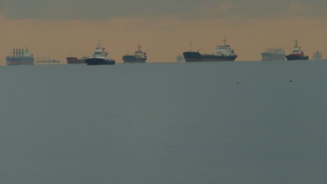 cargo ships outer roadstead in the sea - towing stock videos and b-roll footage