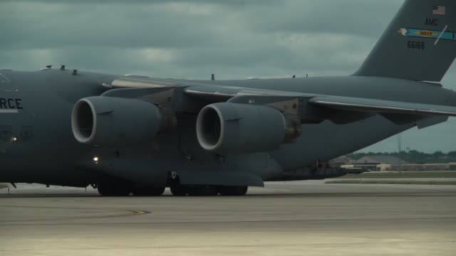 cargo, soldiers and vehicles arrive via c-17 airlift in san antonio, texas and begin staging in lackland air force base to support operation faithful... - us airforce stock videos & royalty-free footage