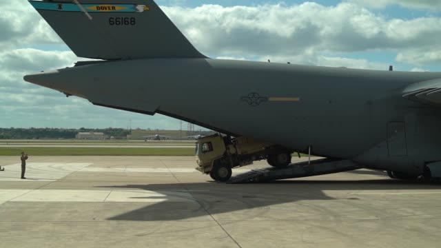 cargo soldiers and vehicles arrive via c17 airlift in san antonio texas and begin staging in lackland air force base to support operation faithful... - lackland air force base stock videos and b-roll footage