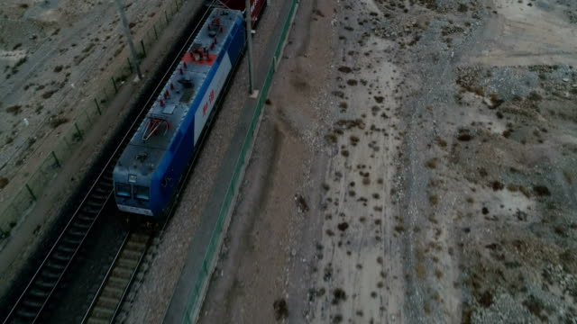 cargo train runs on lanxin railway in china. - belt stock videos & royalty-free footage