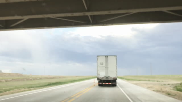 cargo transport long haul semi truck on a rural mid west usa interstate highway 4k video - american interstate stock videos & royalty-free footage