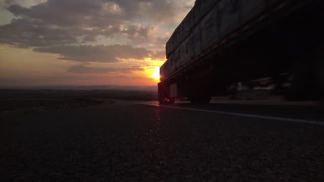 cargo transport long haul semi truck on a rural western usa interstate highway 4k video - industrial equipment stock videos & royalty-free footage