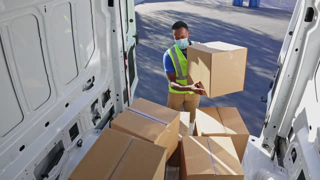 cargo van delivery during pandemic - giving stock videos & royalty-free footage