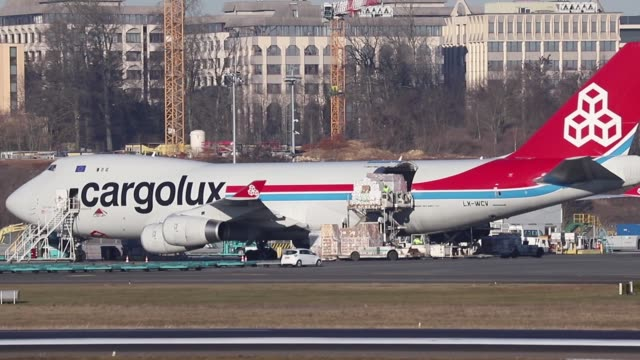 Cargolux Airlines International Boeing 747400F getting loaded and taxiing for take off at its hub Luxembourg Findel Airport LUX / ELLX The aircraft...