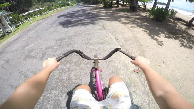 pov caribbean bike ride - board shorts stock videos and b-roll footage